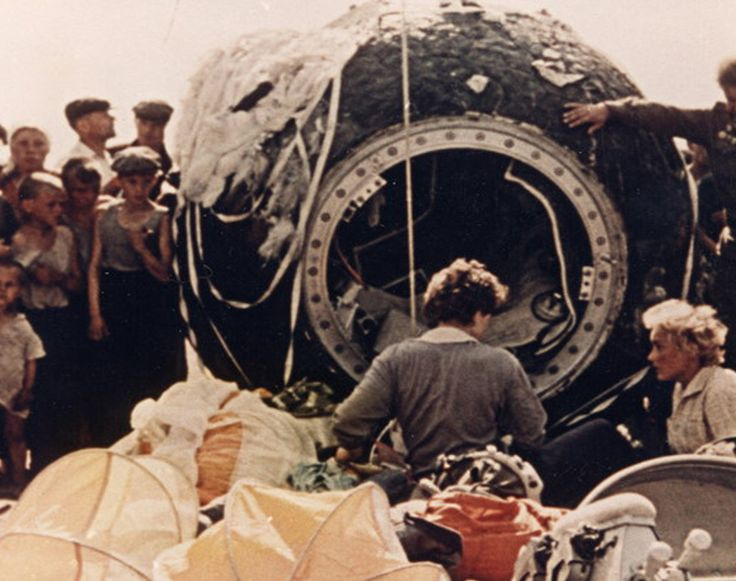 Valentina Tereshkova (back to camera) outside of her Vostok 6 spacecraft